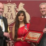 Dr ,Nilayini receiving the Best Enterprise & CEO Of the Year2014